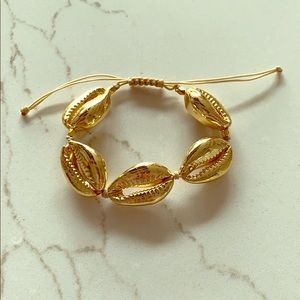 Cowrie Sea Shell adjustable bracelet. Faux gold.